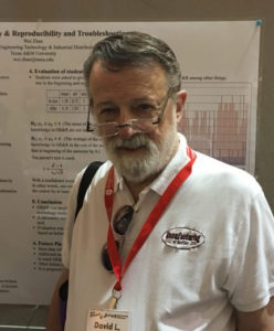 Dr. David Wells in front of an ASEE Conference poster presentation